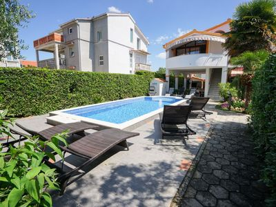 Photo for This 7-bedroom villa for up to 12 guests is located in Zadar and has a private swimming pool, air-co