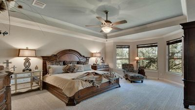 Master bedroom has King bed and full size sleeper sofa.  Views of Lake Travis.