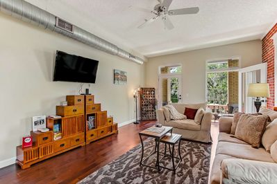 Living Area with Doors to the Balcony where you can relax and enjoy the neighborhood views and the downtown skyline!