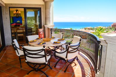 Comfortable outdoor dining with azure ocean views and seasonal whale watching