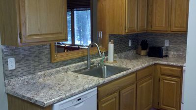 kitchen with new countertop and backsplash