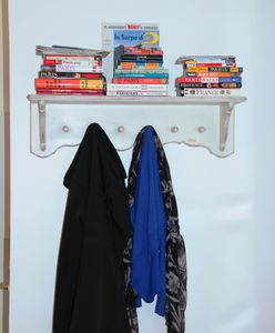 Coat rack with guidebooks.