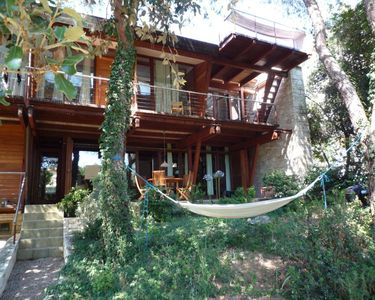 Photo for Beautiful architect's house surrounded by beautiful pine forest, 150 m from the beach
