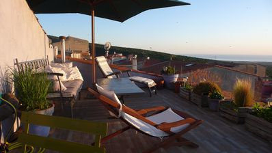 Photo for near Bosa, terrace with sublime sunsets over sea