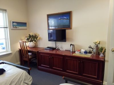 Study desk, flat screen TV, DVD player and refreshments at hand.