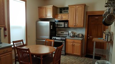 Our Kitchen North view. Stainless Steel Fridge and Stove.  Our Breakfast Table.