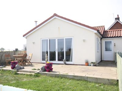 Photo for Sea View bungalow, spacious open plan and pet friendly.
