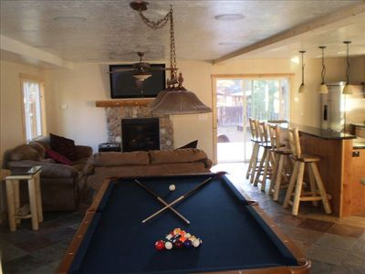 Spacious and open downstairs with pool table, 50' TV, and surround sound
