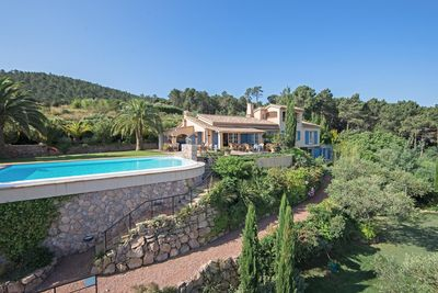 Villa Loth Lorien with pool, stairway to Middle Earth Way, and the Olive Garden