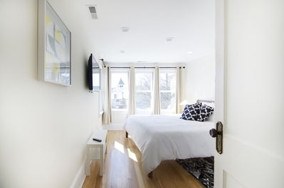 Entry to bedroom with king size bed, western views of mountains
