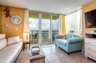 The living room's view is spectacular - The airy living room opens onto the balcony, which in turn overlooks the soft white sands and the serene beach. You'll love the area with its bountiful wildlife, estuaries, and biking.
