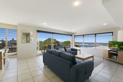 Unit 2 - Tiled living area opening to deck - ocean views