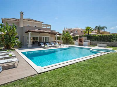 Photo for Modern 4 bedroom villa in quiet area w/ terrace, BBQ & private pool