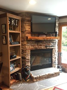 NEW wood burning fire place w/ large flat screen tv & entertainment center!