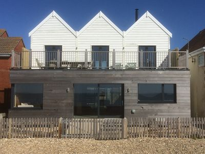 Photo for Twitterings - A Stunning New Beach House On The Sea Front At West Wittering.