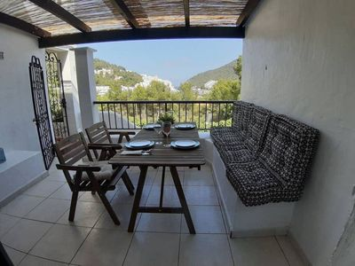 Photo for Holiday Home Casita en Cala Llonga with Sea View, Wi-Fi, Terrace, Balcony, Shared Garden & Shared Pool; Parking Available