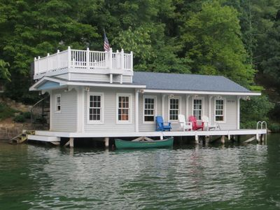 Modern Boathouse (the cottage is tucked behind the trees above the boathouse).