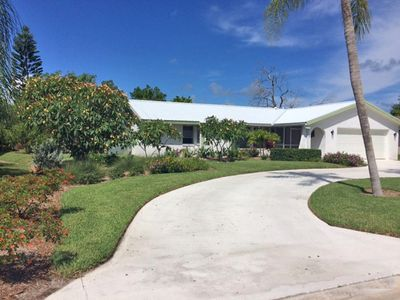 Photo for Pool home with brand new furnishings and on the Hibiscus Course