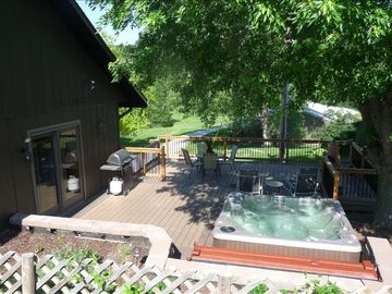 Enjoy the spacious deck that overlooks the beautiful 20 acres.