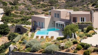 Photo for Villa Elounda has a fabulous location, nestled in gentle hillside amongst mature gardens and olive t