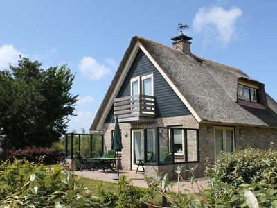 Photo for Riet Covered luxury villa on Texel for 6 people near the beach in De Koog