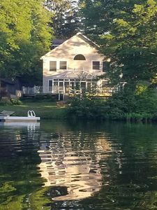Back of Home with Swim Raft.  True lakefront and not just access.