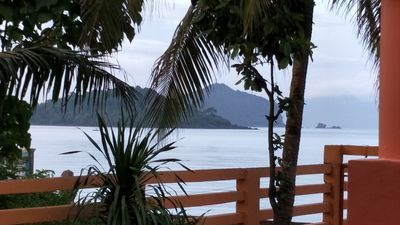 Photo for Relaxing beach side condo with mountain and island views.