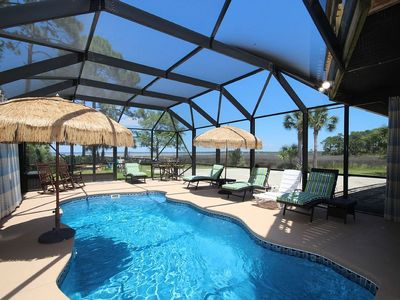 Photo for Secluded Bay Front Family home Private Screened Heated Pool, Hot Tub, Sleeps 12