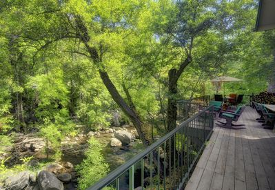 400 feet of creek runs through the property below the generous large decks.