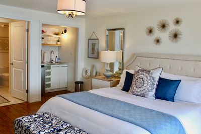 The Roost suite with kitchenette and luxurious King bed.