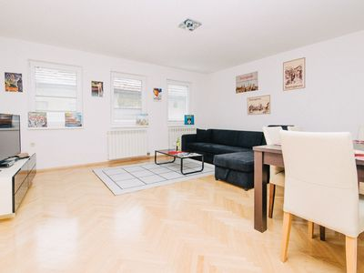 Photo for Bright apartment with HUGE GARDEN & FREE GARAGE