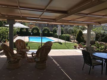 Chalet with large living room, beautiful garden and swimming pool.
