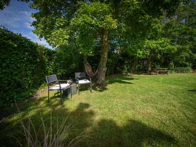 Photo for A beautifully furnished, detached 6-person bungalow (4 adults and 2 children) with a green garden is located in the middle of the park and within walking distance to the Veerse Meer