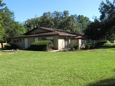 Photo for AFFORDABLE: quiet 1 bedroom apt; pvt.patio; trees; UF, downtown, shopping 1.5 mi