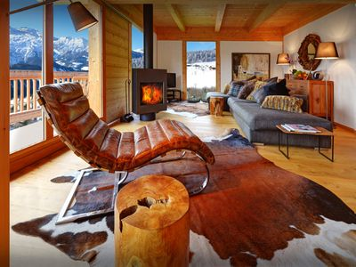 Photo for Cosy sofas and crackling fire at this 4* chalet near village - OVO Network