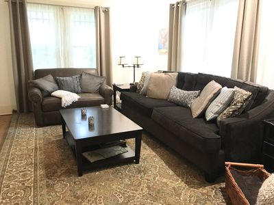 8 foot sofa and love seat with a pull out twin bed in livingroom