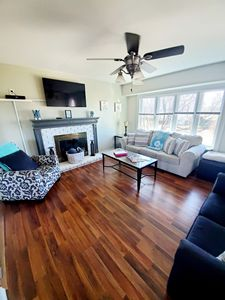 Living room equipped with a fireplace, smart TV & Cable. queen sofa bed