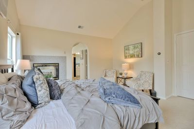 The beautiful master bedroom features a king bed, a comfortable seating area perfect for reading or morning coffee, a large en-suite bathroom with both a standing shower and a large tub, and an attached study/sitting area for a very decadent experience.