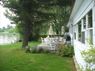 Rear of Cottage and Patio which faces the St. Lawrence River