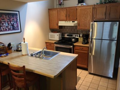 Full Kitchen, stainless steel appliances, w/ 2 stool counter seating for guests
