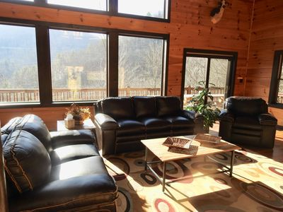 Get comfy in new leather living room furniture center around fire place & TV.
