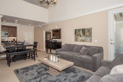 Bright, spacious living and dining room area with soaring 18 foot ceiling!