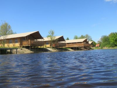 Photo for Luxurious safari tent with veranda, located on pond of spacious holiday park