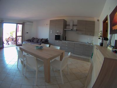 Photo for three-room apartment with 2 bathrooms, large terrace and garden.