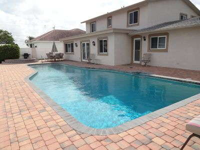 Photo for $299/NT MAY-DEC 14- STUNNING 5 BEDROOM,HEATED POOL,POMPANO BEACH/FORT LAUDERDALE