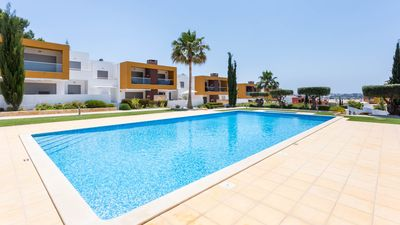 Photo for UP TO 24% OFF! Modern ground floor apt, 3 pools, garden, AC, free WiFi