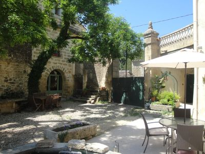 Photo for Apart. in 18th century farmhouse with heated pool, near Pont du Gard