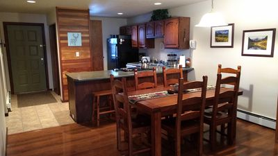 Fully stocked kitchen and spacious dining room for your home away from home.