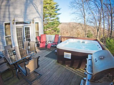 Photo for Modern four bedroom home with a Hot Tub, Swimming Pool and a Game Room.