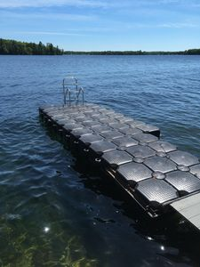 20' dock with 12' of depth off the end and swim ladder.